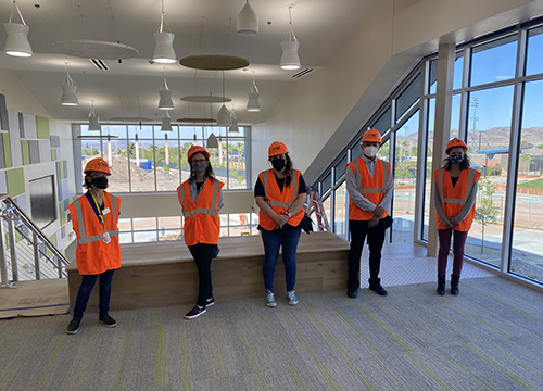 Library staff in hard hats and safety vests